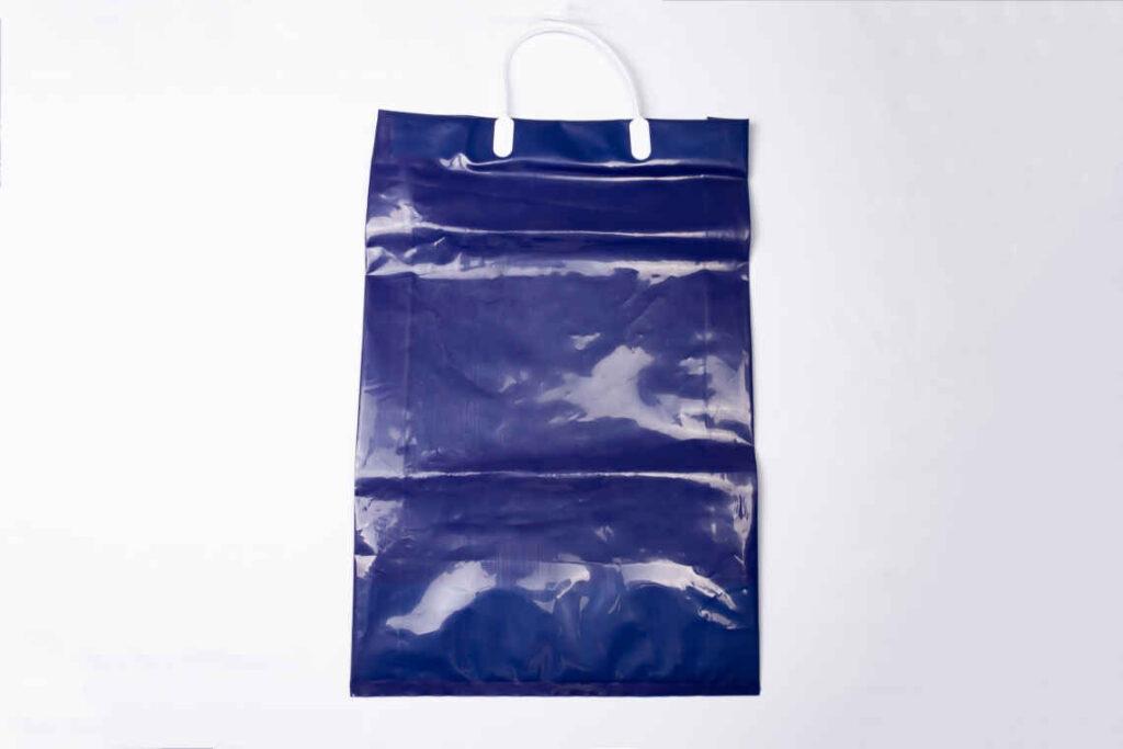 プラスチック取っ手付き袋/ハッピータック付き袋のOEM生産
